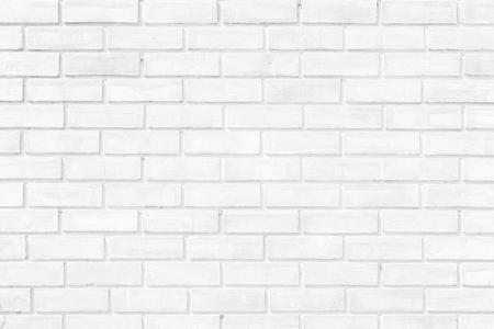 White brick wall texture background. Brickwork or stonework flooring interior rock old pattern clean concrete grid uneven bricks design stack.