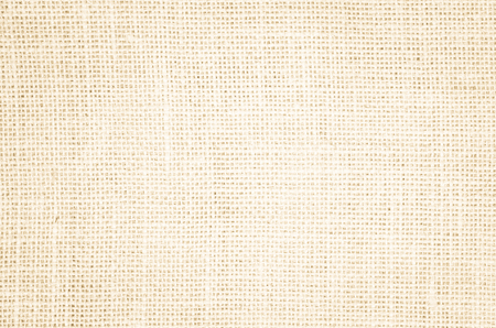Cream abstract Hessian or sackcloth fabric or hemp sack texture background. Wallpaper of artistic wale linen canvas. Blanket or Curtain of cotton pattern with copy space for text decoration. 版權商用圖片