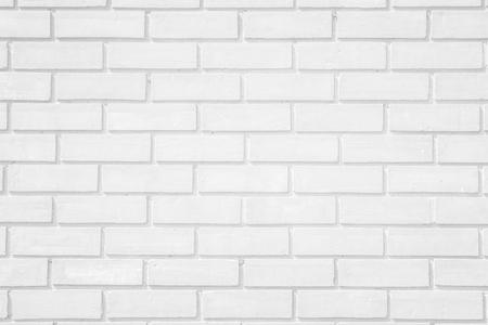 Wall white brick wall texture background. Brickwork or stonework flooring interior rock old pattern clean concrete grid uneven bricks design stack. Reklamní fotografie