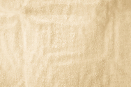 Cream abstract cotton towel mock up template fabric on wite background. Wallpaper of artistic wale linen canvas. Blanket or Curtain of pattern and copy space for text decoration. Clipping path.