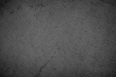 Kunstschwarze Betonsteinbeschaffenheit für den Hintergrund in Schwarz. haben farbe trocken zerkratzte oberfläche wandabdeckung abstrakte bunte papierkratzer schäbige vintage zement und sandgraue dunkle detailbedeckung.