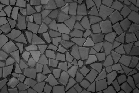 Broken tiles mosaic seamless pattern. Black Dark tile real wall high resolution real photo or brick seamless with texture interior background. Abstract wallpaper irregular in bathroom. Imagens