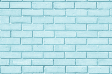 Brick wall painted with pale blue paint pastel calm tone texture background. Brickwork and stonework flooring interior rock old pattern clean concrete grid uneven bricks design stack.