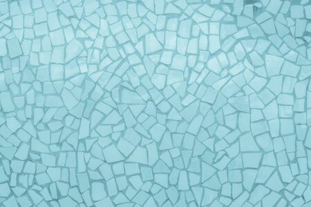 Broken tiles mosaic seamless pattern. Blue tile real wall high resolution real photo or brick seamless with texture interior background. Abstract wallpaper irregular in bathroom. Stock Photo