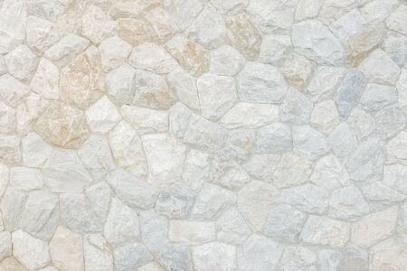 Brick stone wall stack of medieval natural stone texture background or rock strata boundary the rock seamless abstract and fragment of a walls from a gray chipped stones ancient.