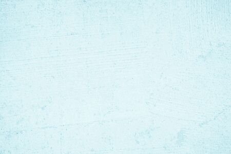 Blue and White concrete or stone texture for background in black wallpaper. Cement and sand wall of tone vintage.