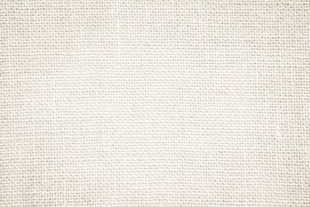 Asciugamano di tela di sacco astratto crema mock up tessuto modello su con sfondo. Sfondo di una Tela artistica Wale. Coperta o tenda di motivo e copia spazio per la decorazione del testo. Parete di design d'interni.
