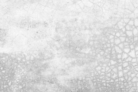 Grunge concrete wall at covered with gray cement old surface with crack in industrial building, great for your design and texture background. Black and white cracked floor texture vintage concept.