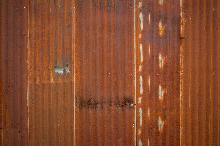 Old Zinc rust texture background, close up to pattern texture vertical zinc sheet. Abstract  Image of Rusty corrugated metal vintage background view. Wall steel older dirty grunge surface fence house.