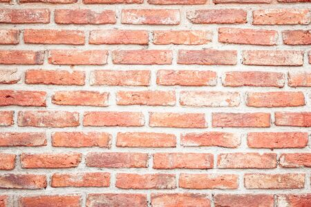Orange brick wall concrete or stone texture background, wallpaper limestone abstract to flooring and homeworkBrickwork or stonework clean grid uneven interior rock old. Copy space.