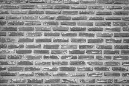 Abstract Wall black brick wall texture background pattern, brick surface backgrounds. Vintage Brickwork or stonework flooring interior rock old clean concrete grid uneven, wallpaper bricks design. Stock Photo