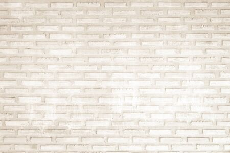 Wall cream brick wall texture background in room at subway. Brickwork stonework interior, rock old clean concrete grid uneven abstract weathered bricks tile design, horizontal architecture wallpaper. Stock Photo