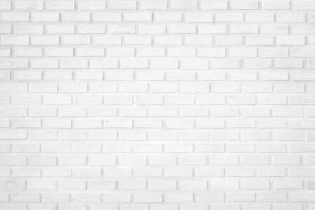 Fondo bianco di struttura del muro di mattoni della parete nella stanza alla metropolitana. Interni in muratura di pietra, roccia vecchia griglia di cemento pulita irregolare design di piastrelle di mattoni stagionati astratti, carta da parati di architettura orizzontale.