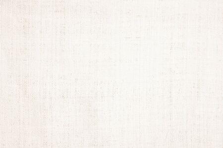 Creme abstrakte Baumwolltuch Mock-up-Vorlage Stoff auf Hintergrund. Stofftapete aus kunstvollem grauem Leinen-Leinwand. Stoffdecke oder Vorhang aus Muster und Kopienraum für die Textdekoration.