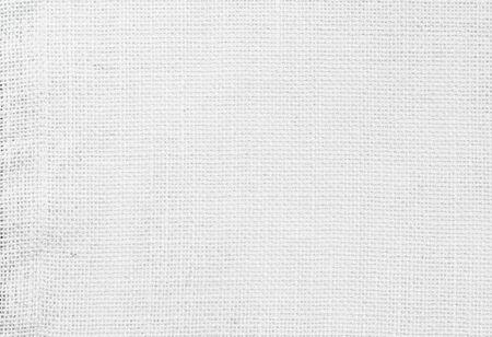 Weißes abstraktes Baumwolltuch mock-up Vorlagenstoff auf Hintergrund. Stofftapete von künstlerischer grauer Wal-Leinen-Leinwandstruktur. Stoffdecke oder Vorhang aus Muster und Kopienraum für die Textdekoration. Standard-Bild