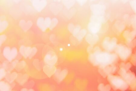 Blurred background of Valentines day concept. Pink Valentines Day Card. Pastel color tone soft have gradient pattern. Multicolor white pink, orange and red hearts blur wallpaper in love bright sexy.