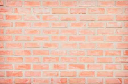 Background of wide old red brick wall texture. Old Orange brick wall concrete or stone wall textured, wallpaper limestone abstract flooringGrid uneven interior rock. Home or office design backdrop.