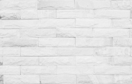 Medieval natural stone wall texture background or boundary the rock seamless abstract and decor fragment of design vintage wallpaper pattern chipped ancient from white color for interior copy space.