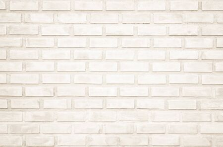 Background of wide cream brick wall texture. Old brown brick wall concrete or stone wall textured, wallpaper limestone abstract flooringGrid uneven interior rock. Home or office design backdrop.
