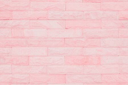 Seamless Pink pastel pattern of decorative brick sandstone wall surface with concrete of modern style design decorative uneven have cracked realmasonry wall of multicolored stones or blocks white cement.