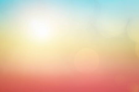 Natural background blurring warm colors and bright sun light. Bokeh or Christmas background Green Energy at sky sunny color orange light patterns plain abstract flare evening clouds blur. Reklamní fotografie