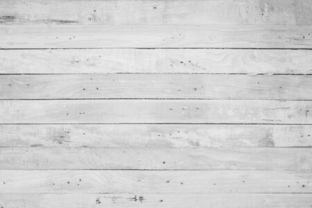 Wood plank white timber texture background. Old wooden wall all have antique cracking furniture painted weathered peeling wallpaper . Vintage table plywood woodwork hardwoods at summer for copy space.
