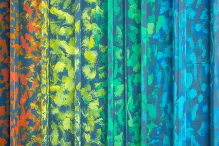 Multicolor zinc texture, Art color metal door. Wall room background container office design. Materials to build a house for sun and rain protection. Closeup modern texture pattern steel home decor.