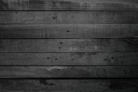 Grunge dark wood plank texture background. Vintage black wooden board wall antique cracking old style background objects for furniture design. Painted weathered peeling table wood hardwood decoration.