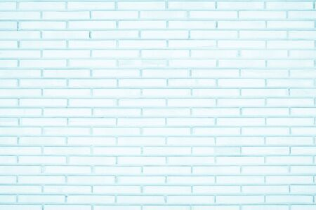 Pastel Blue and White brick wall texture background. Brickwork painted of blue color interior rock old pattern clean concrete grid uneven brick design stack. Home or office design backdrop decoration.