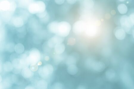 Natural spring blurred blue sea background. Create light soft blurred colors bright sunshine. Blue bokeh abstract glitter light background. Focus texture from nature fresh shiny growth seas the day. Banque d'images