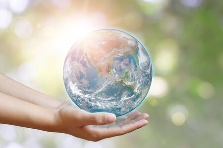 International Day of Forests and earth day concept. Hands holding blue earth globe in business hands on green blurred background for world environment day, Ecology. Banque d'images