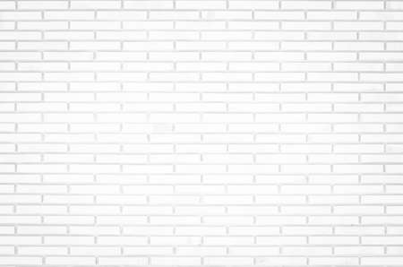 White brick wall texture background in room at subway. Brickwork stonework interior, rock old clean concrete grid uneven abstract weathered bricks tile design, horizontal architecture wallpaper.