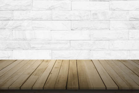 Empty wooden table top on white brick wall background, Design wood terrace white. Perspective for show space for your copy and branding. Can be used as product display montage. Vintage style concept.