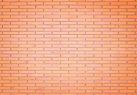 Background of wide old red brick wall texture. Old Orange brick wall concrete or stone wall textured, wallpaper limestone abstract flooring/Grid uneven interior rock. Home or office design backdrop. Banque d'images - 151149792