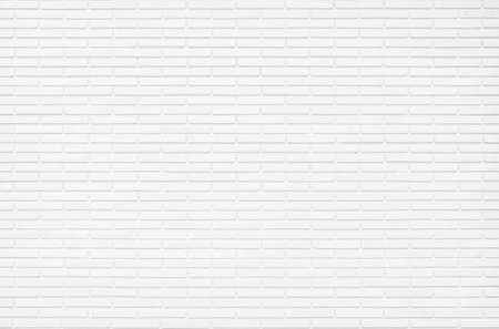 White brick wall texture background in room at subway. Brickwork stonework interior, rock old concrete grid uneven abstract weathered grey clean tile design, horizontal architecture wallpaper.