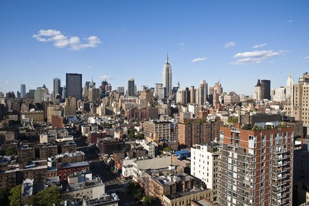 office buildings: New York cityscape with apartments and office buildings. The Empire State building is visible in the background. Horizontal shot. Stock Photo