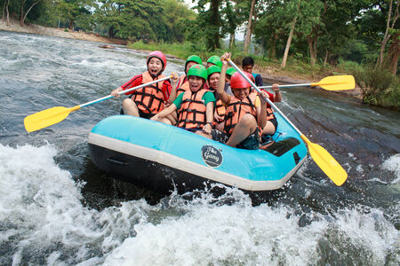 powerfull: Group of powerfull young men on a rafting boat