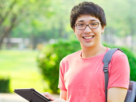 Young Asian student using tablet photo
