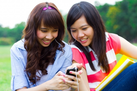 Girls listening to music together. photo