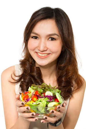 Healthy young woman with salad