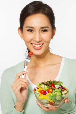 Healthy young woman with salad photo