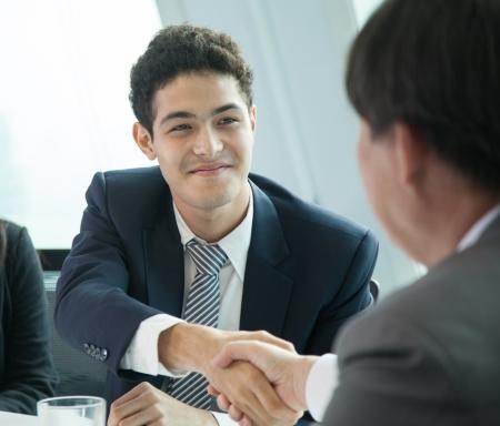 manager: Business Handshake Stock Photo