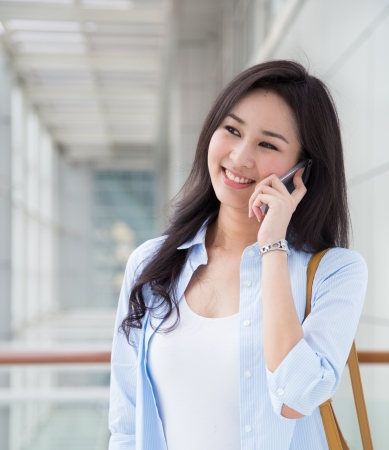 pretty young woman: Young woman talking on the phone