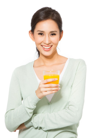 Young woman holding a glass of orange juice. photo