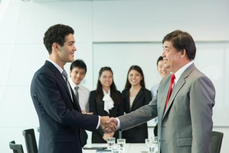 Business people handshaking photo