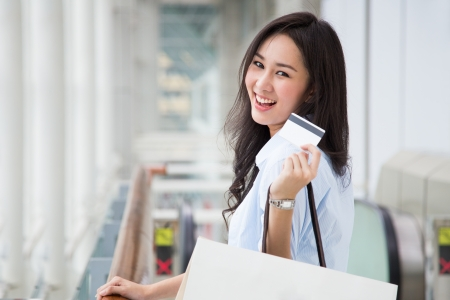 Asian woman shopping photo