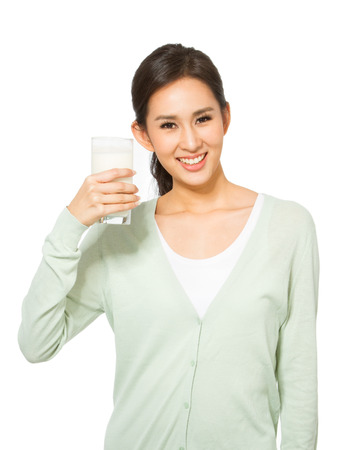 Young woman drinking milk.