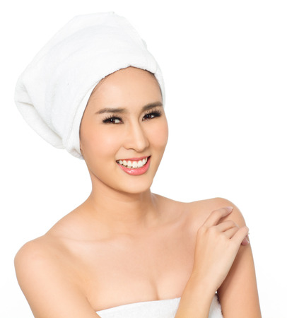 dry hair: Asian woman wearing white towels for spa beauty treatment.