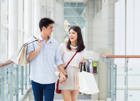 Asian couple go shopping together.
