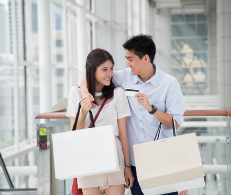 Asian couple go shopping together. photo